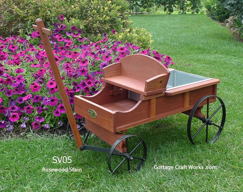 A Miniature Replica Of A Buckboard Wagon Garden Decor Planter