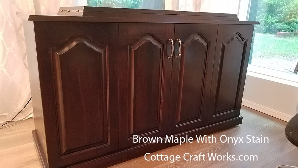 sewing machine cabinet with power lift