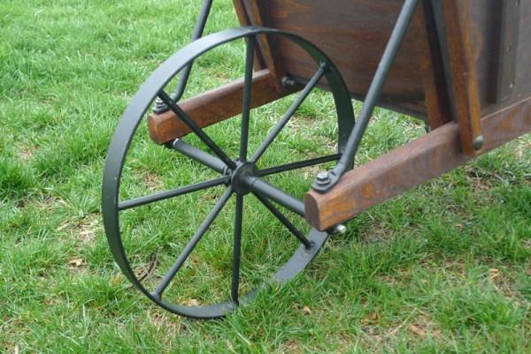 Old Fashioned Reproduction Wood And Metal Spoke Wheelbarrows